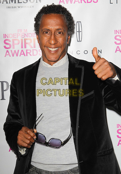 Andre Royo.2013 Film Independent Filmmaker Grant And Spirit Awards Nominees Brunch held at BOA Steakhouse, West Hollywood, California, USA..January 12th, 2013.half length top black grey gray suit jacket  hand arm thumb up.CAP/ADM/KB.©Kevan Brooks/AdMedia/Capital Pictures.