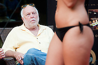Jury member Andy Vajna watches Mercedesz Lukacs a participant  of the Beauty Queen contest has a bath in Hotel Abacus, Herceghalom, Hungary on July 07, 2011. ATTILA VOLGYI