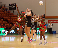 27.10.2013 Silver Fern Joline Henry and Malawi's Jessie Mazengera and Bridget Kumwenda in action during the Silver Ferns V Malawi New World Netball Series played at the Pettigrew Green Arena in Napier. Mandatory Photo Credit ©Michael Bradley.