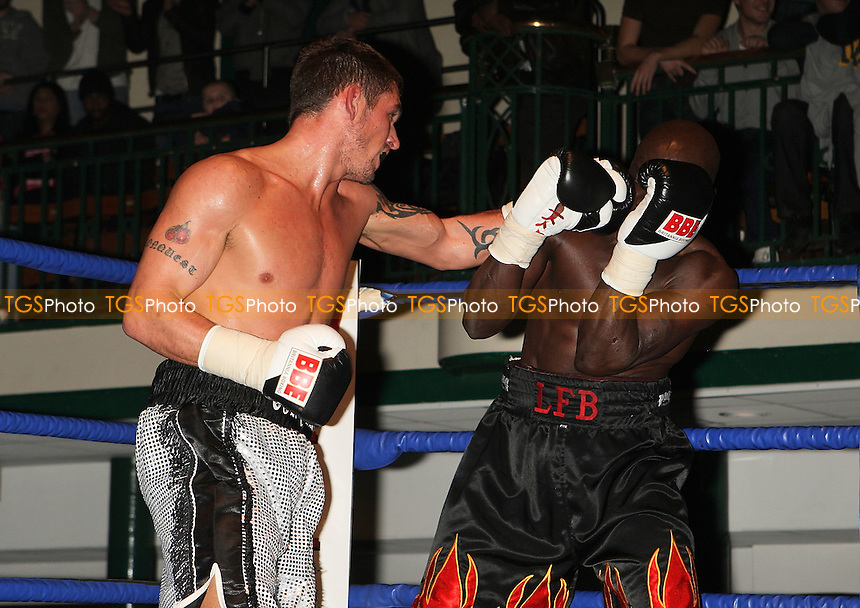 Tony Conquest (silver shorts) defeats Nick Okoth in a Cruiserweight boxing contest at York Hall, Bethnal Green, promoted by Left Jab / Miranda Carter - 06/12/09 - MANDATORY CREDIT: Gavin Ellis/TGSPHOTO - Self billing applies where appropriate - Tel: 0845 094 6026