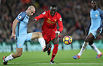 Sadio Mané of Liverpool and Pablo Zabaleta of Manchester City during the English Premier League match at Anfield Stadium, Liverpool. Picture date: December 31st, 2016. Photo credit should read: Lynne Cameron/Sportimage