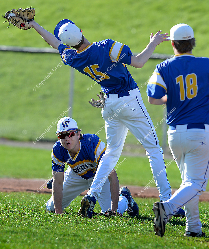 Madison West's Otto Treichel catches a fly in traffic, as Memorial tops West 2-0 in Big Eight Conference high school baseball on Tuesday, 4/23/19 at Mansfield Stadium field at Memorial High School in Madison, Wisconsin