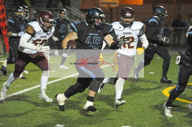 Chugiak's Kenny Lee charges upfield with Dimond's Taylor Dintzner and Dylan Tufaga giving chase.  Photo for the Star by Michael Dinneen