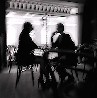 Couple seated at cafe