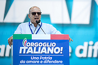 """Donato Toma (Member of Forza Italia, President of Molise Region).<br /> <br /> Rome, 19/10/2019. Today, tens thousands of people (200,000 for the organisers, 50,000 for the police) gathered in Piazza San Giovanni to attend the national demonstration """"Orgoglio Italiano"""" (Italian Pride) of the far-right party Lega (League) of Matteo Salvini. The demonstration was supported by Silvio Berlusconi's party Forza Italia and Giorgia Meloni's party Fratelli d'Italia (Brothers of Italy, right-wing).  <br /> The aim of the rally was to protest against the Italian coalition Government (AKA Governo Conte II, Conte's Second Government, Governo Giallo-Rosso, 1.) lead by Professor Giuseppe Conte. The 66th Government of Italy is a coalition between Five Star Movement (M5S, 2.), Democratic Party (PD – Center Left, 3.), and Liberi e Uguali (LeU – Left, 4.), these last two parties replaced Lega / League as new members of a coalition based on Parliamentarian majority as stated in the Italian Constitution. The Governo Conte I (Conte's First Government, 5.) was 14-month-old when, between 8 and 9 of August 2019, collapsed after the Interior Minister Matteo Salvini withdrew his euroskeptic, anti-migrant, right-wing Lega / League (6.) from the populist coalition in a pindaric attempt (miserably failed) to trigger a snap election.<br /> <br /> Footnotes & Links:<br /> 1. http://bit.do/feK6N<br /> 2. http://bit.do/e7JLx<br /> 3. http://bit.do/e7JKy<br /> 4. http://bit.do/e7JMP<br /> 5. http://bit.do/e7JH7<br /> 6. http://bit.do/eE7Ey<br /> https://www.leganord.org<br /> http://bit.do/feK9X (Source, TheGuardian.com)<br /> Reportage: """"La Fabbrica Della Paura"""" (The Factory of Fear): http://bit.do/feLcy (Source Report, Rai.it - ITA)<br /> (Update) Reportage: """"La Fabbrica Social Della Paura"""" (The Social Network Factory of Fear): http://bit.do/fe8Pn (Source Report, Rai.it - ITA)"""