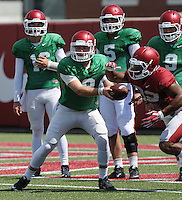 NWA Democrat-Gazette/ANDY SHUPE<br /> Arkansas quarterback Austin Allen (8) hands the ball off Tuesday, Aug. 11, 2015, to running back Jonathan Williams during practice at the university's practice field in Fayetteville.