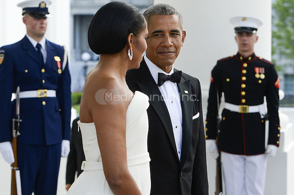 United States President Obama and the First Lady Michelle Obama await the arrival of Prime Minister Lee Hsien Loong and Madam Ho Ching at the North Portico of the White House in Washington, DC on Tuesday, August 2, 2016. <br /> Credit: Leigh Vogel / Pool via CNP/MediaPunch
