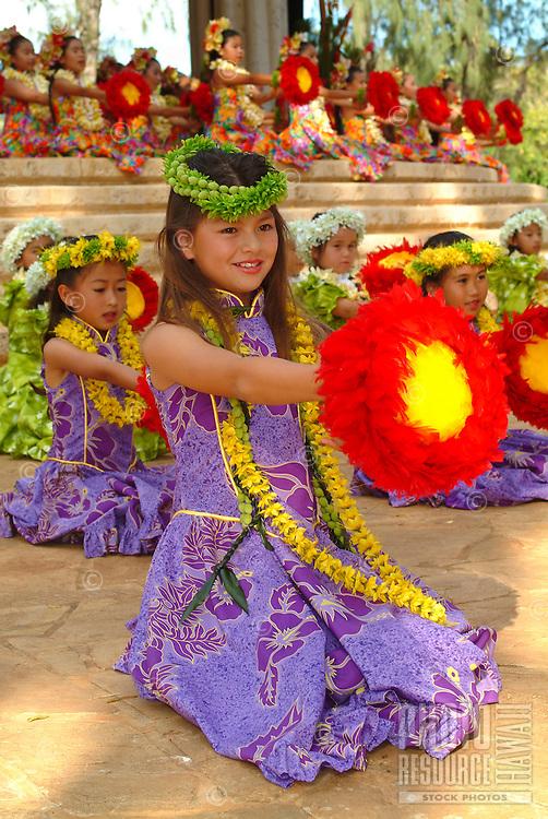A lei day performance by Halau Hula O Hokulani at the Waikiki bandstand in Kapiolani park.