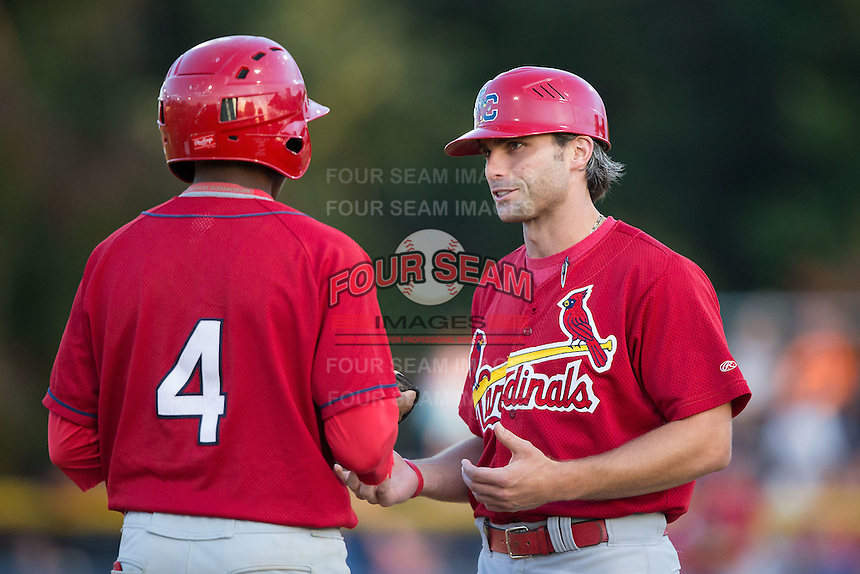 Johnson City Cardinals manager Chris Swauger (8) discusses base running with Anthony Ray (4) during the game against the Burlington Royals at Burlington Athletic Park on August 22, 2015 in Burlington, North Carolina.  The Cardinals defeated the Royals 9-3. (Brian Westerholt/Four Seam Images)