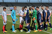 Joe Worrall of England exchanges pennants with Scotland's Oliver Burke during England Under-18 vs Scotland Under-20, Toulon Tournament Semi-Final Football at Stade Parsemain on 8th June 2017