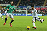 (L-R) Hal Robson-Kanu of West Bromwich Albion tries to block a cross by Martin Olsson of Swansea City during the Premier League match between Swansea City and West Bromwich Albion at The Liberty Stadium, Swansea, Wales, UK. Saturday 09 December 2017