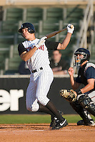 Jon Gilmore #20 of the Kannapolis Intimidators follows through on his swing versus the Asheville Tourists at Fieldcrest Cannon Stadium April 11, 2009 in Kannapolis, North Carolina. (Photo by Brian Westerholt / Four Seam Images)
