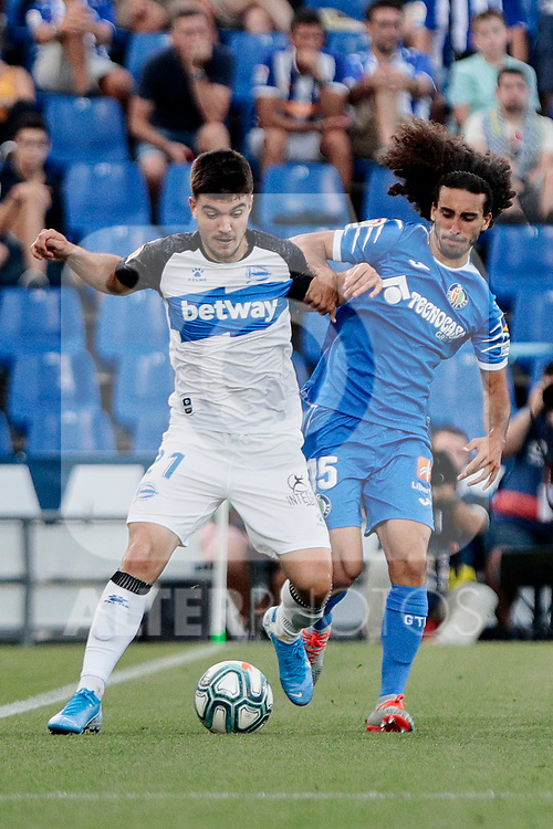 Marc Cucurella of Getafe CF and Martin Aguirregabiria of Deportivo Alaves during La Liga match between Getafe CF and Deportivo Alaves at Colisseum Alfonso Perez in Getafe, Spain. August 31, 2019. (ALTERPHOTOS/A. Perez Meca)