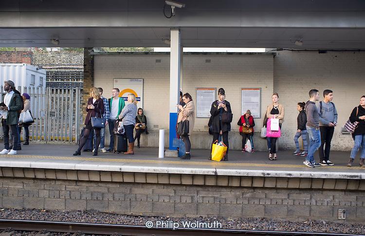 Passengers waiting on Highbury & Islington train station platform London