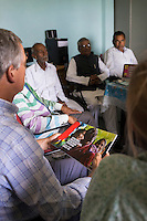 Fairtrade personnel from Switzerland and India make a presentation to a small group of Fairtrade Cotton Farmer Leaders in Vasudha Vidya Vihar school in Khargone, Madhya Pradesh, India on 12 November 2014. Photo by Suzanne Lee for Fairtrade