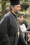 Greek Parade in New York City. A Greek Orthodox priest walks in the Greek Parade in New York City.