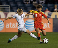 Rachel Buehler (26) of the USWNT tries to tackle the ball away from Sun Ling (15) of China during an international friendly at PPL Park in Chester, PA.  The U.S. tied China, 1-1.