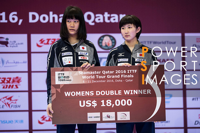 Yui Hamamoto and Hina Hayata of Japan poses with their prize after finishing the Seamaster Qatar 2016 ITTF World Tour Grand Finals at the Ali Bin Hamad Al Attiya Arena on 11 December 2016, in Doha, Qatar. Photo by Victor Fraile / Power Sport Images