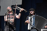 Sergey Ryabtsen and Yuri Lemeshev of Gogol Bordello perform during the Hangout Music Fest in Gulf Shores, Alabama on May 19, 2012.