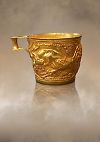 Vapheio type Mycenaean gold cup depicting a wild bull hunt side C , Vapheio Tholos Tomb, Lakonia, Greece. National Archaeological Museum of Athens. <br /> <br />  Two masterpieces of Creto - Mycenaean gold metalwork were excavated from a tholos tomb near Lakonia in Sparta in 1988. Made in the 15th century BC, the gold cups are heavily influenced by the Minoan style that was predominant in the Agean at the time. The bull hunt was popular with  Mycenaean  and Minoan artists and symolised power and fertility. The distinctive shape of the cup is kown as 'Vapheio type'.