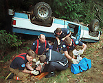 South Kitsap EMT's provide medical attention to a women who lost control of her truck on Highway 16 near Port Orchard, WA.  Jim Bryant Photo