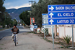 EL PORVENIR, BAJA CALIFORNIA - NOVEMBER 27, 2013:  Signs directing visitors to wineries dot the roadside in the small community of El Porvenir. Residents and wineries in Mexico's wine country are protesting the mayor's relaxing of zoning regulations they say will lead to a drastic change in the culture of  the popular tourist destination.  CREDIT: Max Whittaker for The New York Times