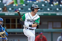 Matt Skole (21) of the Caballeros de Charlotte follows through on his swing against the Buffalo Bisons at BB&T BallPark on July 23, 2019 in Charlotte, North Carolina. The Bisons defeated the Caballeros 8-1. (Brian Westerholt/Four Seam Images)