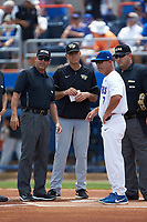 Wake Forest Demon Deacons head coach Tom Walter (16) listens to Florida Gators head coach Kevin O'Sullivan (7) go over the ground rules prior to Game One of the Gainesville Super Regional of the 2017 College World Series at Alfred McKethan Stadium at Perry Field on June 10, 2017 in Gainesville, Florida. The Gators defeated the Demon Deacons 2-1 in 11 innings. (Brian Westerholt/Four Seam Images)