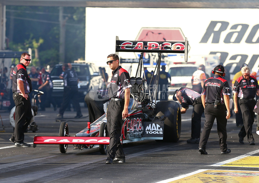 May 31, 2013; Englishtown, NJ, USA: NHRA crew members for top fuel dragster driver Steve Torrence during qualifying for the Summer Nationals at Raceway Park. Mandatory Credit: Mark J. Rebilas-