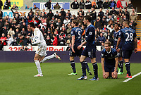 Pictured: Michu of Swansea (L) celebrating his goal to the disappointment of Tottenham players. Saturday 30 March 2013<br />