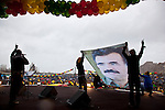 VAN, TURKEY: PKK supporters hold up a photograph of the PKK leader Abdullah Ocalan...Every year on March 21st, Kurds celebrate Newroz, the Kurdish new year. On March 21, 2013, Abudullah Ocalan, the imprisoned leader of the Kurdish separatist group, the PKK, called for his fighters to lay down their arms and retreat to northern Iraq...Photo by Refik Tekin/Metrography