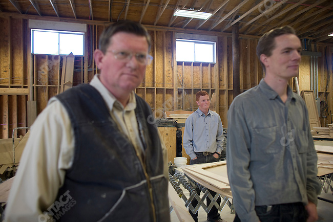"Fundamentalist Mormon group F.L.D.S.,  Edson Jessop (left) working in the wood shop with two of his sons, ""Yearning for Zion"" compound in Eldorado, Texas, USA, February 11, 2009"