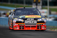 Aug. 8, 2009; Watkins Glen, NY, USA; NASCAR Sprint Cup Series driver Martin Truex Jr during practice for the Heluva Good at the Glen. Mandatory Credit: Mark J. Rebilas-