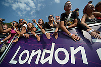 12.08.2012. London, England.  Massed Spectators cheer as they wait for the Athletes competing in the Mens Marathon Competition  London 2012 Olympic Games