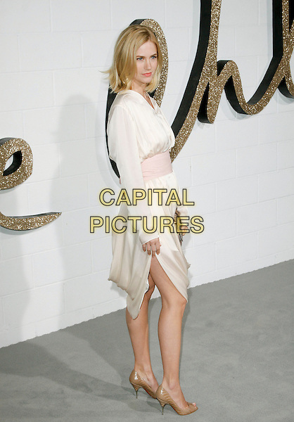 JANUARY JONES .at The Chloe Los Angeles Boutique Opening Celebration held at Milk Studios in Hollywood, California, USA, April 23rd 2009                                                                     .full length  white cream dress pale pink waistband beige open peep toe shoes clutch bag long sleeved sleeves slit split side .CAP/DVS.©DVS/RockinExposures/Capital Pictures