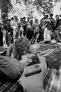 Manhattan, New York City, NY. June 28th 1970. <br /> Two men lie on the ground and kiss for the kissing contest as a crowd gathers around them in Central Park during New York's first Gay Pride celebration.