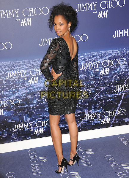 GARCELLE BEAUVAIS-NILON .at The Jimmy Choo for H&M Launch Party in support of The Motion Picture & Television Fund held at  a private residence in West Hollywood, California, USA, November 2nd 2009..full length black beaded dress shoes peep toe sandals ankle strap  hand on hip looking back over shoulder rear behind sleeved sleeves               .CAP/RKE/DVS.©DVS/RockinExposures/Capital Pictures.