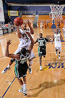 6 February 2010:  FIU's Tremayne Russell (3) shoots over North Texas' Shannon Shorter (21) in the second half as the North Texas Mean Green defeated the FIU Golden Panthers, 68-66, at the U.S. Century Bank Arena in Miami, Florida.