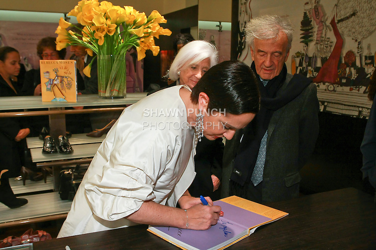 "Rebecca Moses signs book for Elie Wiesel at the Rebecca Moses ""A Life of Style"" book signing at Fratelli Rossetti Boutique, November 11, 2010."