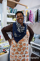 Africa, Swaziland, Malkerns.Nest organization artisan project, partnering with Baobab Batik & local artisans to help market their products to global markets and better sustain their local community. Women selling batik.
