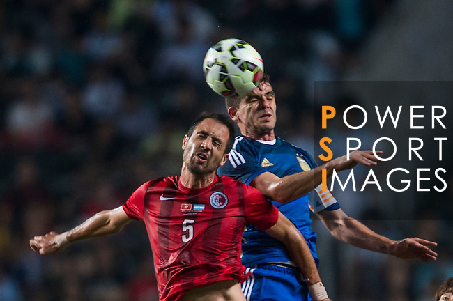 (L) Andy Naegelein of Hong Kong competes for the ball with (R) Fernando Gago of Argentina during the HKFA Centennial Celebration Match between Hong Kong vs Argentina at the Hong Kong Stadium on 14th October 2014 in Hong Kong, China. Photo by Aitor Alcalde / Power Sport Images
