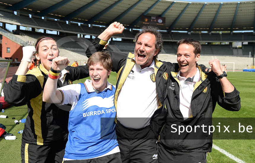 20140410 - BRUSSELS , BELGIUM : Belgian coach Kris Van Der Haegen (middle) pictured celebrating the 1-0 win over Germany  with Belgian Physio  Delphine Jacobs (2nd left) , Belgian Doctor Annelies Harnie (left) and Belgian goalkeepercoach Wouter Vandesteene (right) during the female soccer match between BELGIUM U19 and GERMANY U19 , in the third and final game of the Elite round in group 4 in the UEFA European Women's Under 19 competition 2014 in the Koning Boudewijn Stadion , Thursday 10 April 2014 in Brussels . PHOTO DAVID CATRY