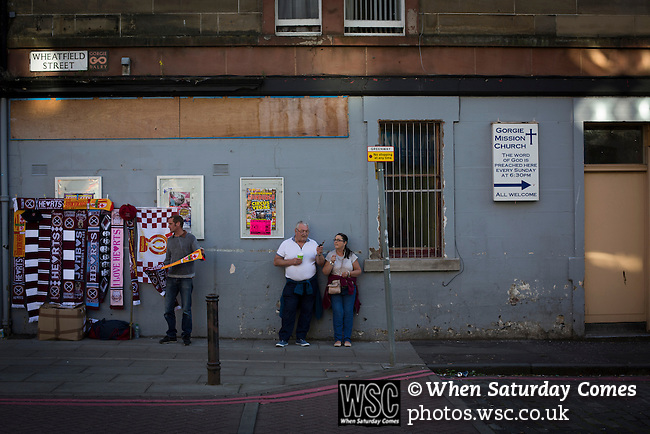 Heart of Midlothian 1 Birkirkara 2, 21/07/2016. Tynecastle Park, UEFA Europa League 2nd qualifying round. A sign for the Gorgie Mission Church and a souvenir stall on Wheatfield Street behind Tynecastle Park, Edinburgh, pictured before Heart of Midlothian played Birkirkara of Malta in a UEFA Europa League 2nd qualifying round, second leg. The match ended in victory for the Maltese side by 2-1 and they progressed on aggregate after the first match had ended 0-0. The game was watched by 14301 spectators, including 56 visiting fans of Birkirkara. Photo by Colin McPherson.