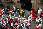 Musicean in the Estafeta street, San Fermin festival 2014, in Pamplona, Spain. Revelers from around the world arrive to Pamplona every year to take part in the running bulls of San Fermin. Photo by Jose Luis Cuesta.