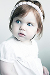 Young girl age 2-5 years old wearing white