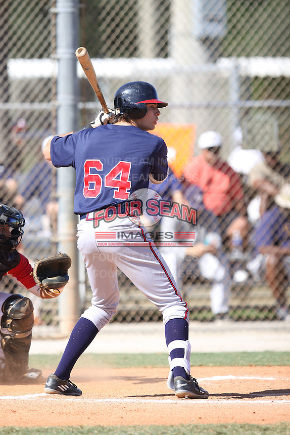 Joshua Lowe (64) of Pope High School (GA) at bat for the Braves Scout Team/Ohio Warhawks at the 2015 WWBA World Championship at the Roger Dean Complex on October 23, 2015 in Jupiter, Florida.  (Stacy Jo Grant/Four Seam Images)