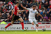 Gylfi Sigurdsson of Swansea City (R) takes a cross past John O'Shea of Sunderland during the Premier League match between Sunderland and Swansea City at the Stadium of Light, Sunderland, England, UK. Saturday 13 May 2017