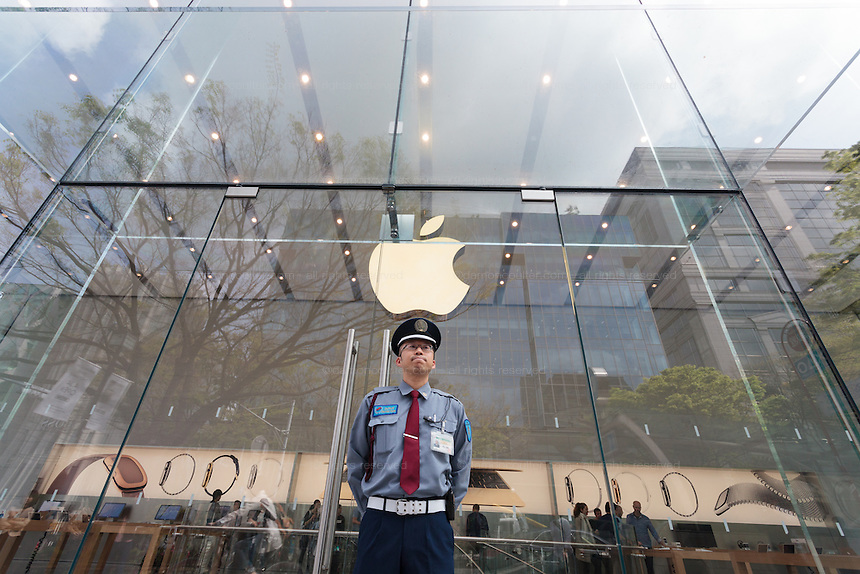 A security guard outside the Apple Store in Omotesando  on the day of the officail release of the Apple watch in Tokyo, Japan. Friday April 24th 2015. Apple's long anticipated  smart watch was officially put on sale in stores in just nine countries. Japan and Australia which are furthest east were the first places in the world where this watch was available for purchase.