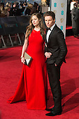 London, UK. 14 February 2016. Actor Eddie Redmayne with his wife Hannah Bagshawe. Red carpet arrivals for the 69th EE British Academy Film Awards, BAFTAs, at the Royal Opera House. © Vibrant Pictures/Alamy Live News