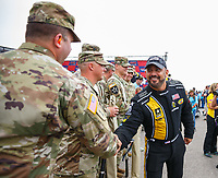 Aug 20, 2017; Brainerd, MN, USA; NHRA top fuel driver Tony Schumacher with US Army soldiers during the Lucas Oil Nationals at Brainerd International Raceway. Mandatory Credit: Mark J. Rebilas-USA TODAY Sports